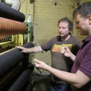 Paul Crookes and staff member Pete spinning the wool